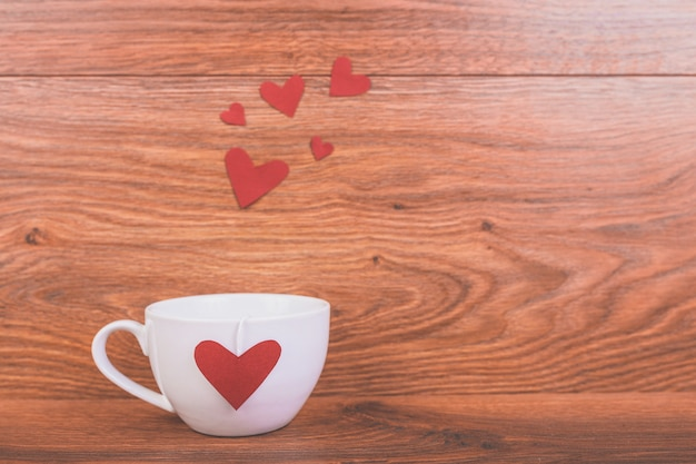 Cup of coffee with a red heart