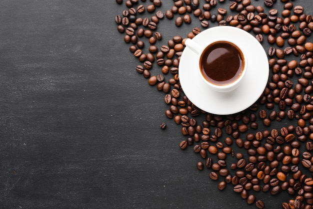 Cup of coffee with roasted beans