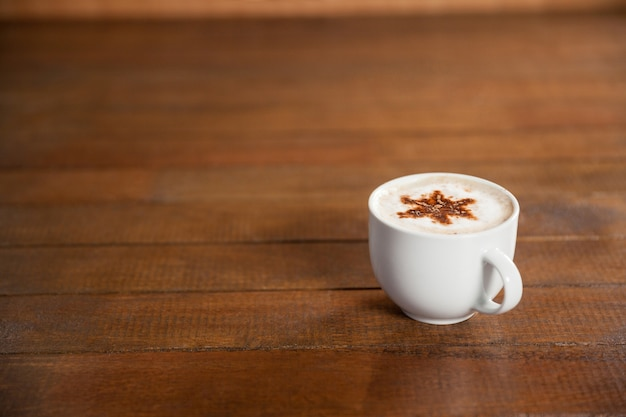 Cup of coffee with star latte art