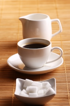 Cup of coffee with sugar and cream