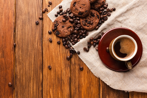 Cup of coffee with tasty cookies