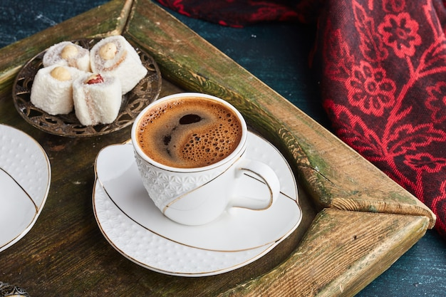 A cup of coffee with turkish lokum.