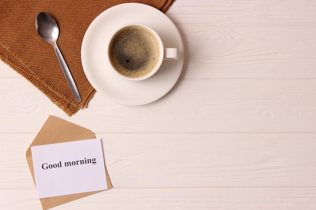Cup of coffee on wooden background top view good morning have a nice day