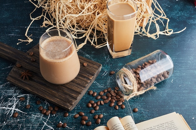 A cup of coffee on a wooden board.