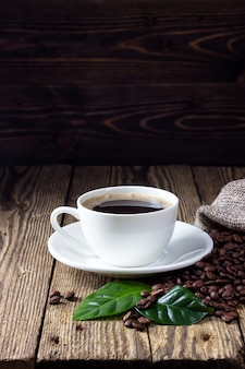 Cup of coffee on wooden rustic table