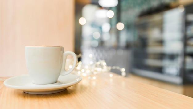 Cup of coffee on wooden table in caf�