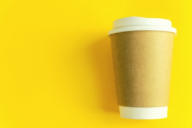 Cup coffee on yellow paper background