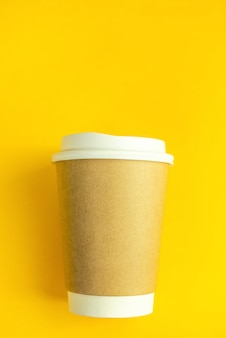 Cup coffee on yellow paper wall. minimal-concept.