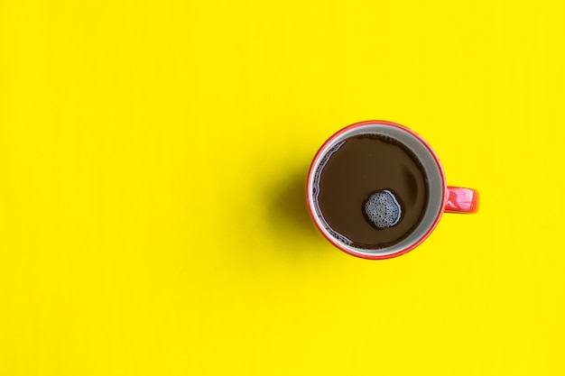 Cup of coffee on yellow