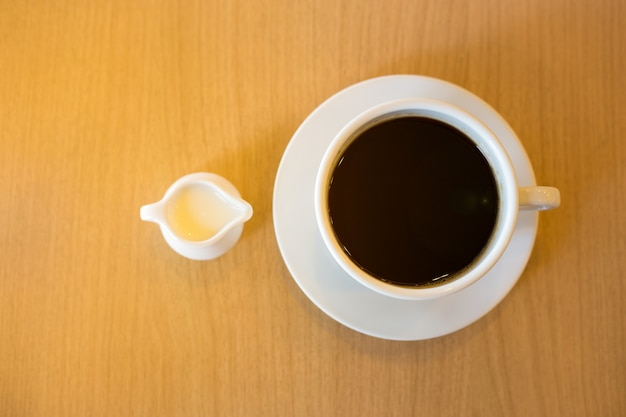 A cup of condensed milk and coffee