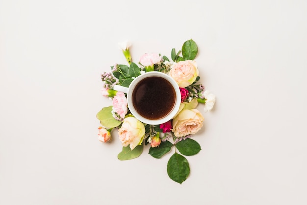 Cup of drink on flower composition