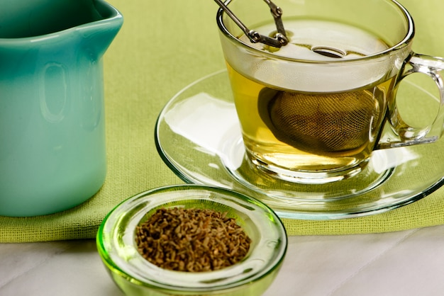Cup of fennel tea with crackers
