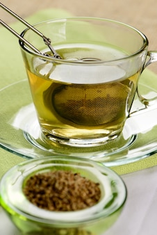 Cup of fennel tea with infuser