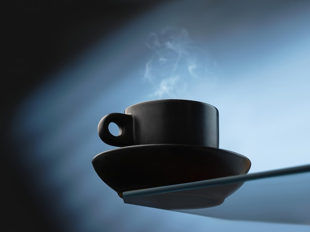 Cup of fresh coffee on blue