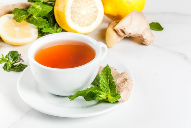 Cup of ginger tea with lemon,fresh mint and honey
