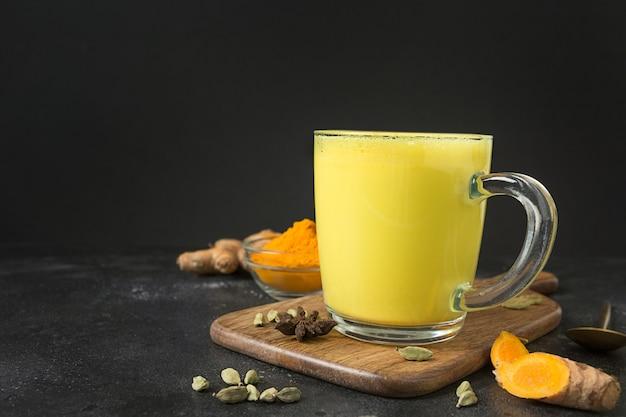 Cup of golden turmeric latte milk
