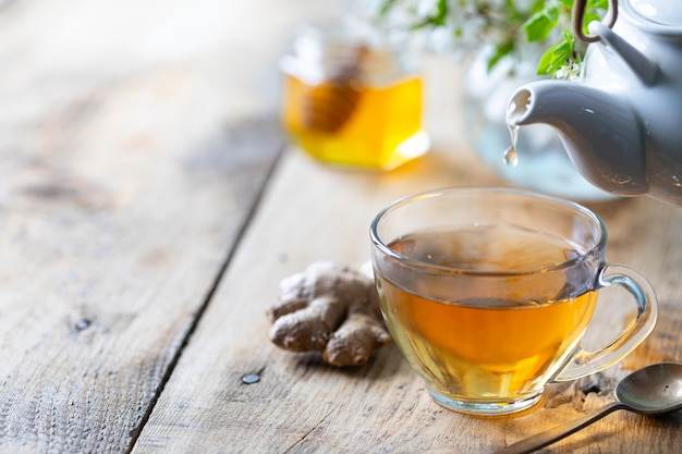 Cup of green tea, ginger, lemon, honey to enhance immunity in the spring. copy space