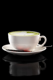 Cup of green tea latte isolated