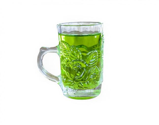 A cup of green tea on wood board