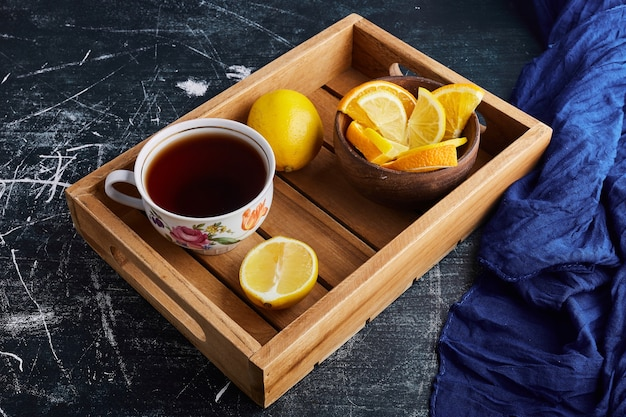 A cup of herbal tea with lemon.