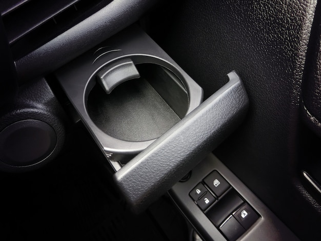 Cup holder in the car with a lock.
