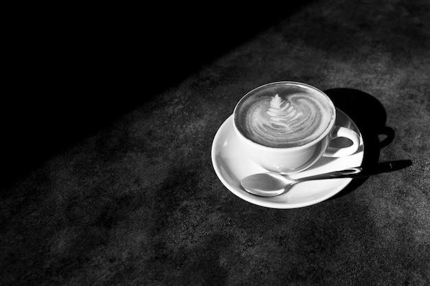 Cup of hot cappucino, hot latte art on table restaurant black and white