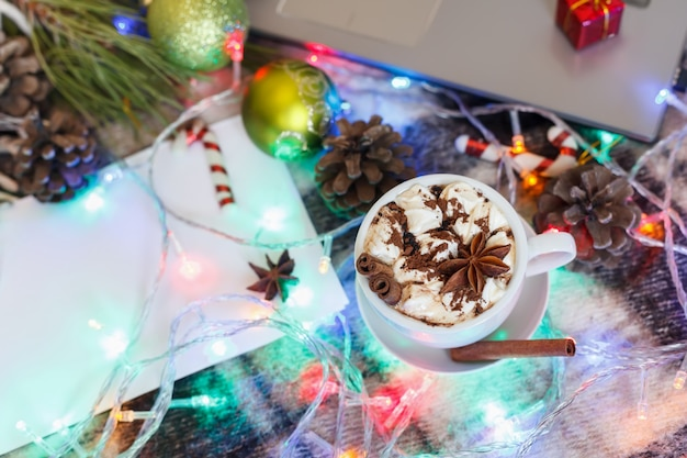 A cup of hot chocolate and marshmallows in christmas decoration. new year background.