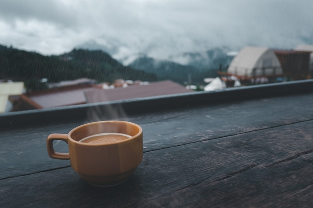Cup of hot coffee in the nature