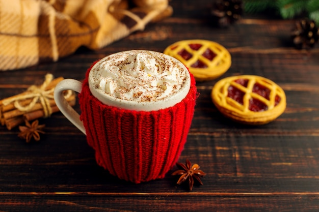 A cup of hot drink with whipped cream and powder