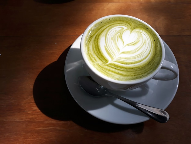 A cup of hot matcha green tea latte or japanese green tea with some milk