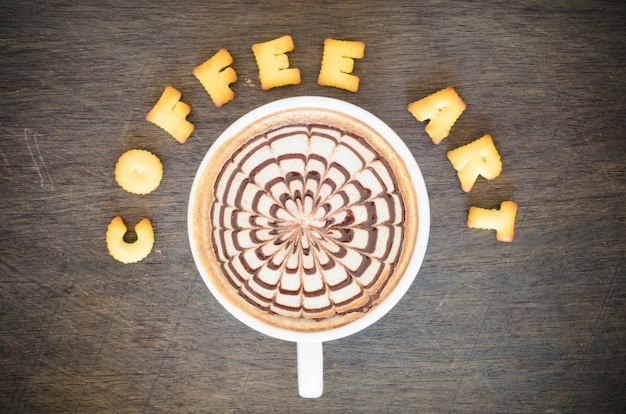 A cup of latte art and alphabet