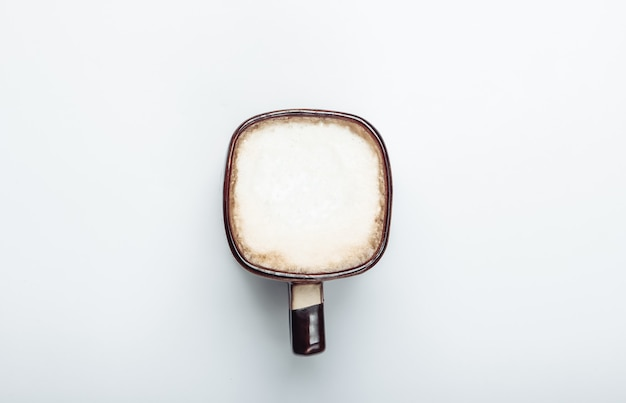 Cup of latte or cappuccino on a white background. coffee with milk. top view
