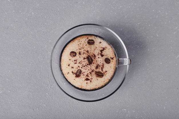 A cup of latte isolated on grey background.