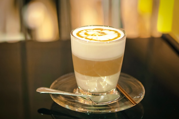 Cup of latte macchiato topped with caramel