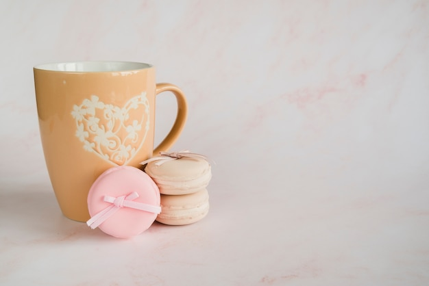 Cup and macaroons cookie