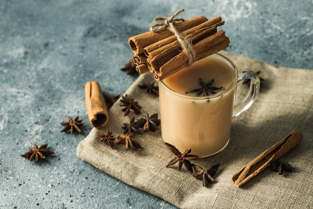 Cup of masala tea with cinnamon and star anise