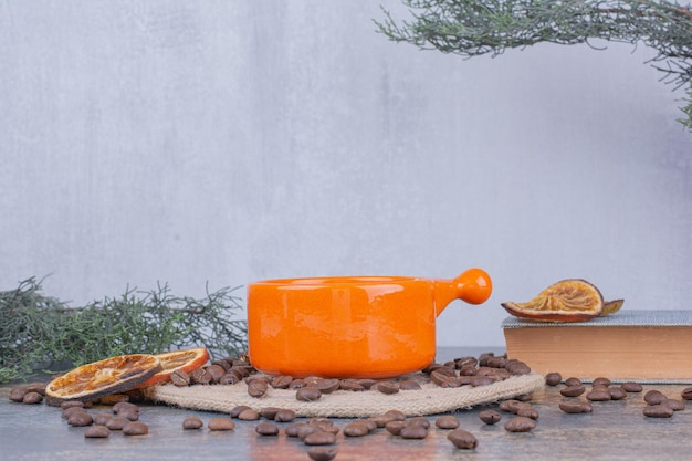 Cup of milk coffee with coffee beans and oranges. high quality photo