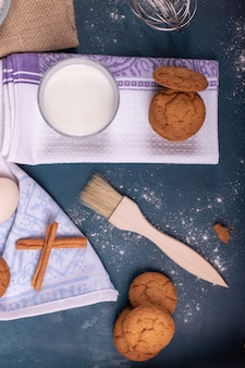 Cup of milk with biscuits and brush