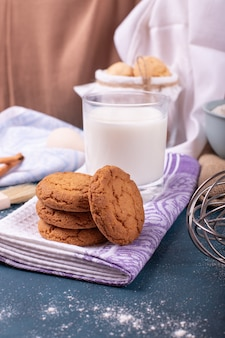 Cup of milk with cinnamon biscuits and flour
