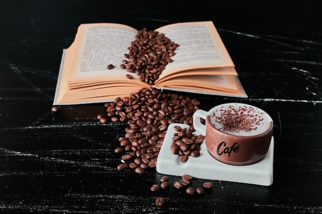 Cup of milk with coffee beans and powder.