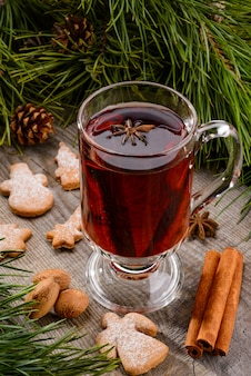 Cup of mulled wine and cinnamon