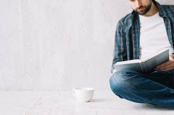 Cup near reading man