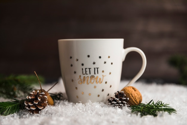 Cup near snags, nuts and twigs on snow