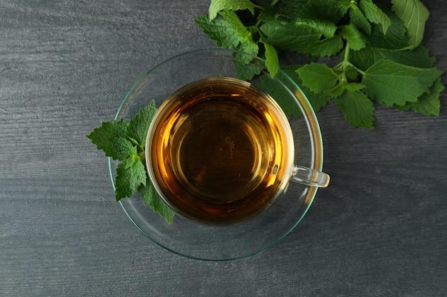 Cup of nettle tea on dark wooden table