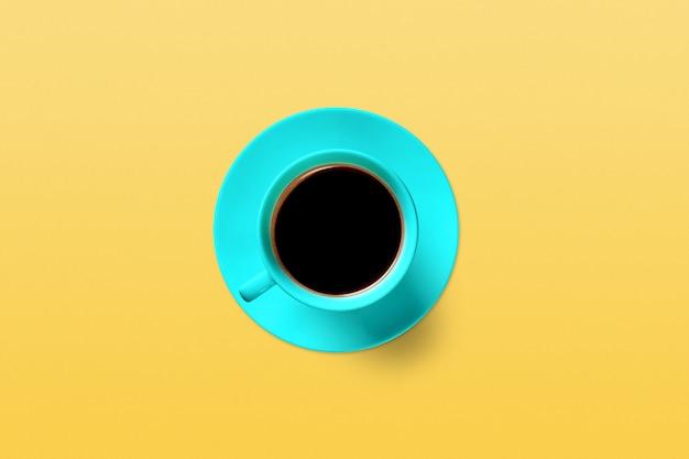 ターコイズ色の背景の上にコーヒーを1杯