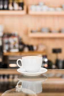 Cup of coffee on counter in caf� shop