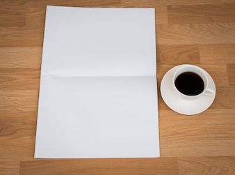 Cup of coffee with a paper