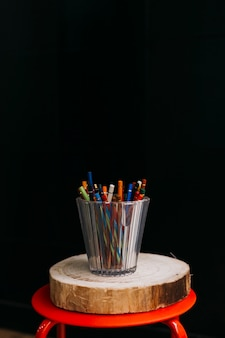 Cup of pencils on stool