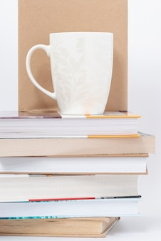Cup placed on stack of books