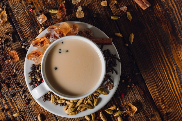 Cup of spiced infusion with milk